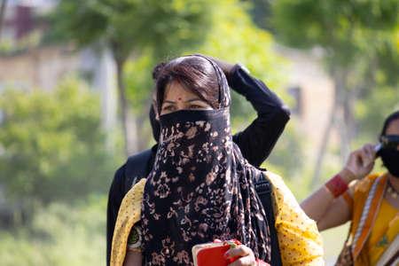 Dehradun, Uttarakhand/India - September 06 2020:Women covering her face or wearing face mask. Editoriali