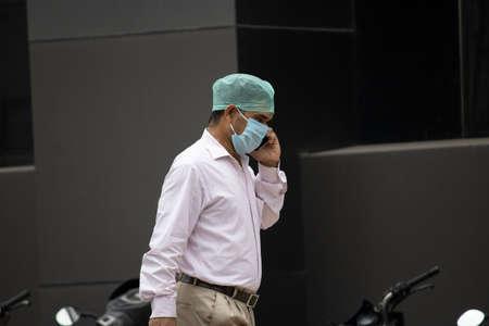 Dehradun, Uttarakhand/India - September 08 2020:A Men wearing face mask, talking on mobile phone.