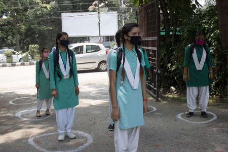 Dehradun, Uttarakhand/India - September 08 2020: Girls Students standing in circles made for social distancing, wearing face mask. Editoriali