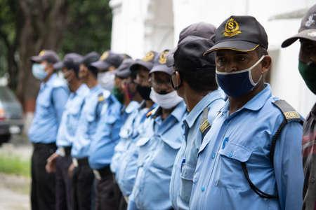 Dehradun, Uttarakhand/India - September 08 2020:Security guard wearing face mask. Editoriali