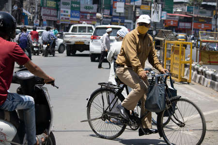 Dehradun, Uttarakhand/India - September 10 2020:A Men riding bicycle wearing face mask. Editoriali