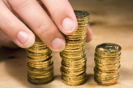 businesslike: Stacking Up Coins Stock Photo