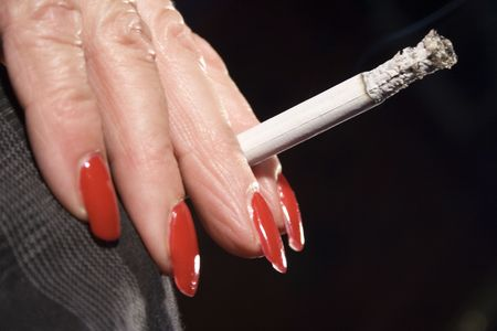 Red Fingernails and Cigarette (Side View) photo