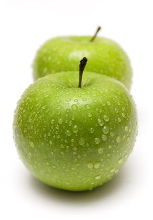 apple green: Two Green Apples in a Row Stock Photo