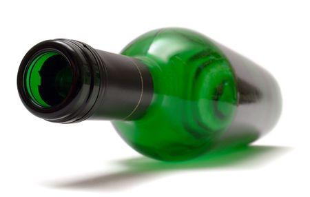 rich flavor: Empty Lying Wine Bottle Stock Photo