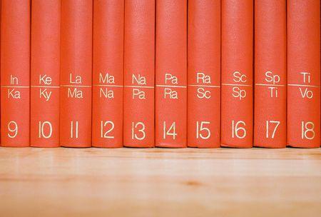 Encyclopedia in a Wooden Bookshelf photo