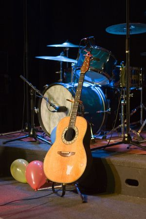 Guitar and Drums on Stage Stock Photo