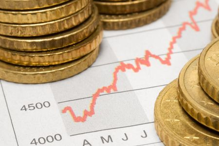 Stock Chart w Stacked Coins Stock Photo