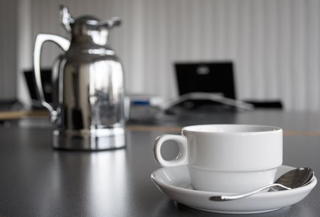 working environment: Cup and Coffee Pot on Desktop