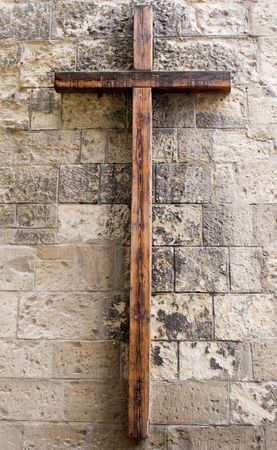supplication: Wooden Cross on Wall Stock Photo