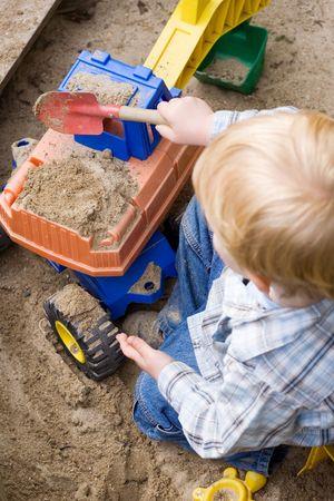 the sandbox: Little Boy Playing Stock Photo
