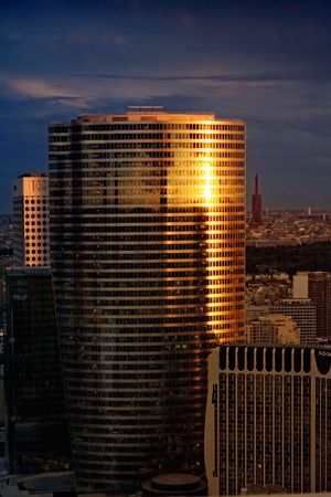 Futuristic office building lit by the setting sun. photo