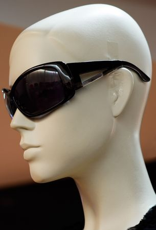 Shop model wearing black designer sunglasses. photo