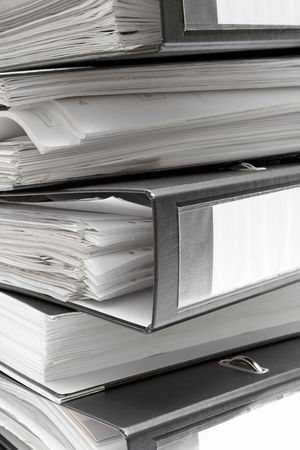 disorganization: Stacked Black File Folders