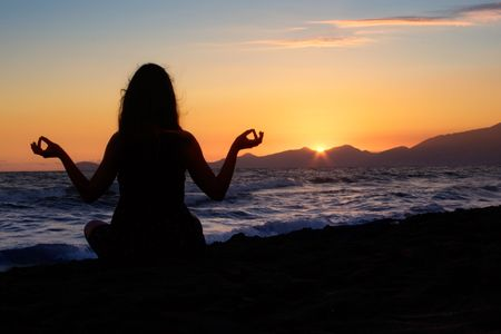 Meditating at the Beach Stock Photo - 1357271