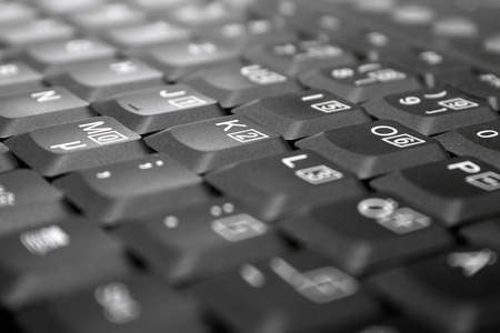 Detail view on gray laptop keys. Shallow depth of field. Focus on M, K, O. Stock Photo - 1432262