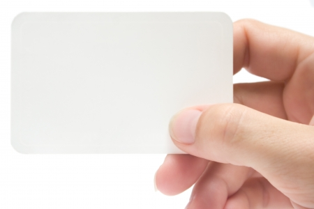 Female hand holding a blank business card. Add your own text. photo