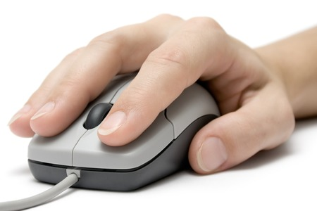 Female hand using a grey computer mouse. Isolated on white background. photo