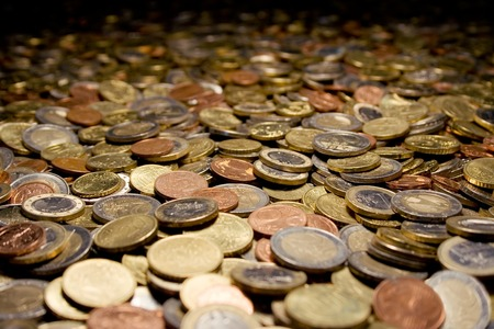 Coins all over the place. Shallow depth of field. photo