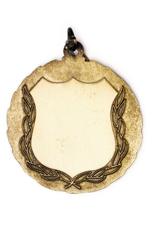 Blank gold medal isolated on a white background. photo