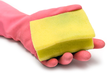 anti bacterial soap: Pink gloves and a yellow cleaning sponge isolated on a white background. Stock Photo