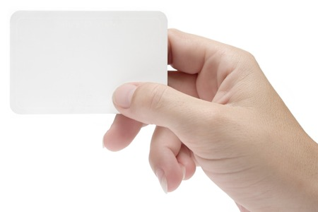 human relations: Female hand holding a blank business card. Add your own text. Isolated on white background.