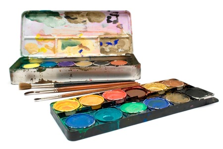 stimuli: Box of watercolors and several brushes isolated on a white background.