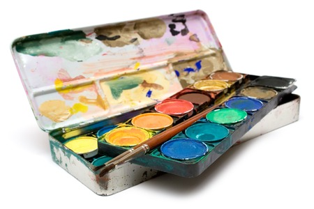 stimuli: Box of watercolors and a pair of brushes isolated on a white background.