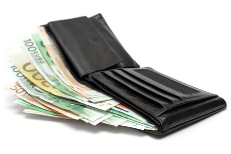 Open leather wallet with banknotes isolated on a white background. photo