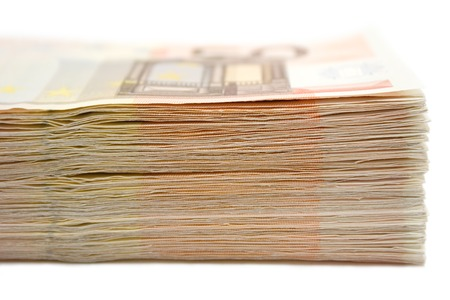 Bunch of 50 Euro banknotes isolated on a white background. Shallow depth of field. photo