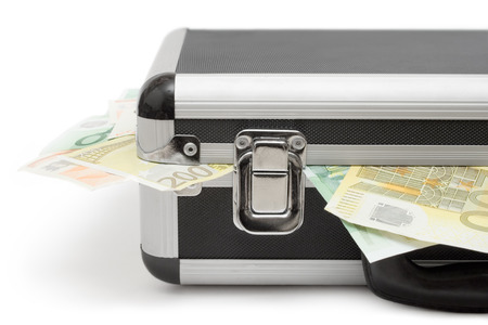 Detail shot of a suitcase full of Euro bills. Isolated on a white background. photo
