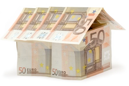 Big House build of fifty euro bills. Isolated on a white background. photo