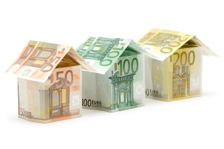 Three colorful houses built of different euro bills. Isolated on a white background. photo