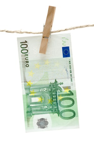 Green one hundred euro bill hanging on a clothesline. Isolated on a white background. photo