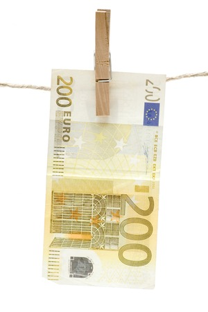cleaning debt: Yellow two hundred euro bill hanging on a clothesline. Isolated on white background.