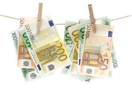 Several different euro banknotes held by a clothesline. Isolated on a white background. photo