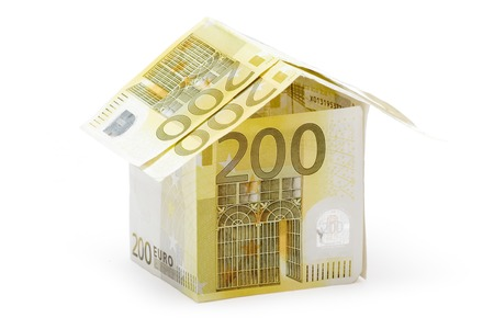 housebuilding: Small house built of several two hundred euro bills. Isolated on a white background. Stock Photo