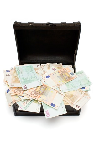 Brown leather case filled with various Euro bills. Isolated on a white background. photo