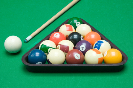 eightball: Cue, triangle and colorful balls ready to play.