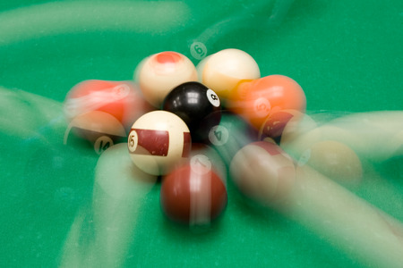 poolball: Colorful billiard balls in motion.