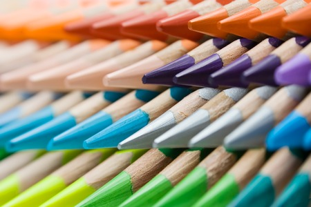 Abstract shot of stacked colored pencils. Shallow depth of field.