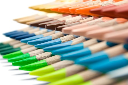 Stacked colored pencils on a white background. Shallow depth of field. photo