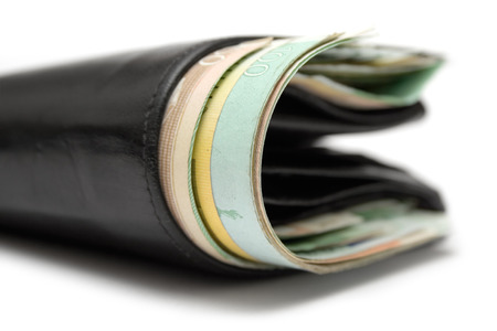 Close view on a black leather wallet full of banknotes. White background. Stock Photo - 1449577