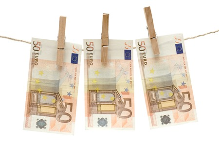 bank note: Three fifty euro bills hanging on a clothesline. Isolated on a white background.