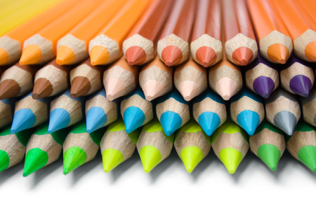 artistically: Stack of colorful pencils isolated on a white background.