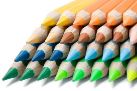 Stack of colorful pencils isolated on a white background.