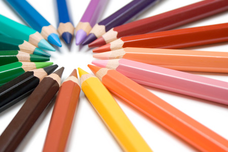 Colorful crayons forming a circle. Isolated on a white background. Stock Photo