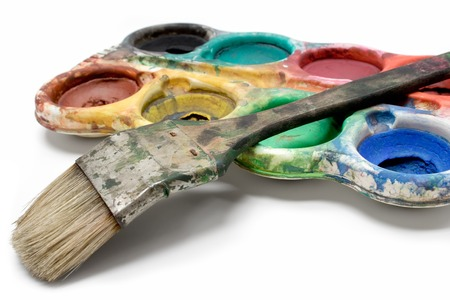 Used colors and dirty paintbrush isolated on a white background. photo