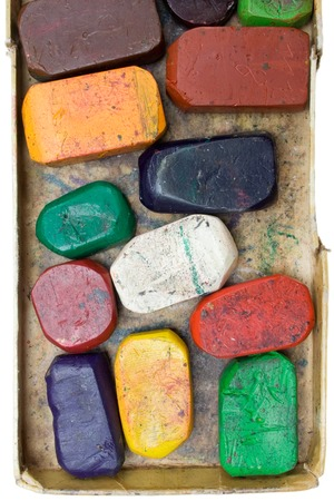 playschool: Colorful wax crayons in an old box. Isolated on a white background. Stock Photo