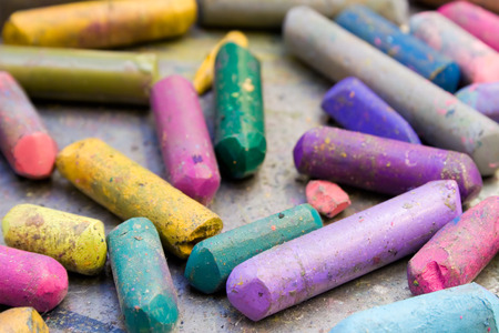 Bunch of colorful used wax crayons. photo
